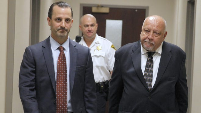 Local psychiatrist William Lewek, who hid the dead body of Mathew Straton in his back yard, right, leaves court Thursday with his attorney Matt Parinello.