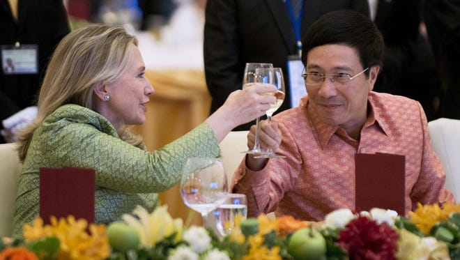 Secretary of State Hillary Clinton toasts Vietnamese Minister of Foreign Affairs Pham Binh Minh in 2012.