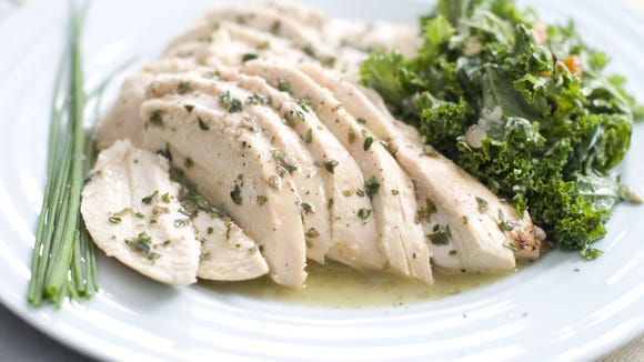 Roasted chicken with fresh herb sauce.