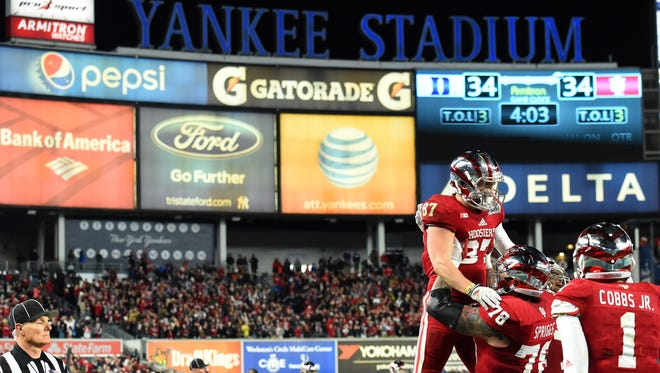 Dec 26, 2015; Bronx, NY, USA; Indiana Hoosiers wide receiver Mitchell Paige (87) celebrates with offensive lineman Jason Spriggs (78) after scoring a touchdown against the Duke Blue Devils during the fourth quarter in the 2015 New Era Pinstripe Bowl at Yankee Stadium. The Blue Devils won 44-41 in overtime. Mandatory Credit: Rich Barnes-USA TODAY Sports