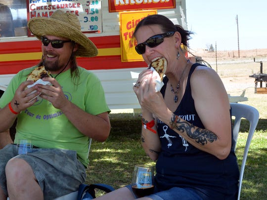 Steve Fardal and Kelly Whitaker enjoy a local favorite quesadilla and a glass of wine Saturday, May 27 at this year's festival.