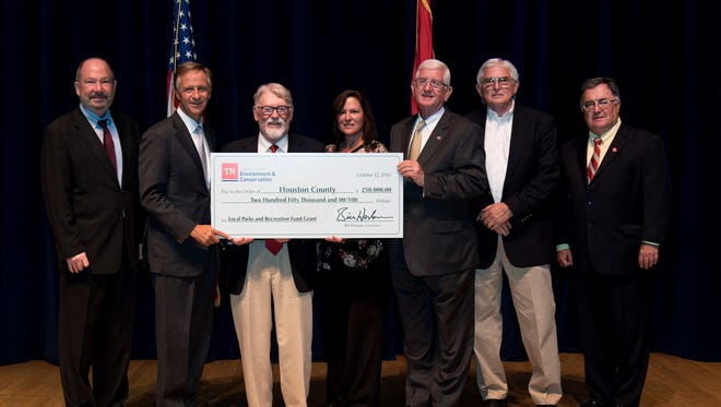 Mayor George E. Clark received a Local Parks and Recreation Fund grant of $250,000 from the Tennessee Dept. of Environmental Conservation on Oct. 12 in Nashville for construction of a concrete boardwalk and landing area, camping amenities, parking and pavilion. Pictured left to right are TDEC Deputy Commissioner Brock Hill; Gov. Bill Haslam; Allen McCampbell, Goodwin Mills & Cawood; Teresa Mitchell, Tourism Committee; Mayor George E. Clark; Jimmy Highers, Goodwin Mills & Cawood; TDEC Commissioner Bob Martineau.