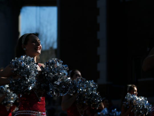 The University of Alabama cheer leaders cheer to fans during the NCAA college football national championship parade, Saturday, Jan. 20, 2018, in Tuscaloosa, Ala. Alabama won the national championship game against Georgia 26-23 in overtime. (AP Photo/Brynn Anderson)
