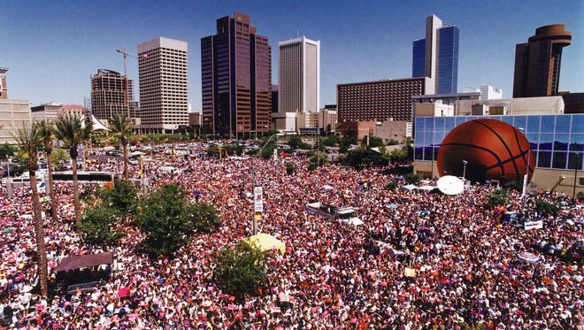 Thousands of fans gather outside what was then America West Arena in downtown Phoenix to greet the Suns after they lost to the Chicago Bulls 4-2 in the best-of-seven 1993 NBA Finals. The Suns' playoff run that year galvanized the city.