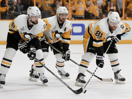 Pittsburgh Penguins players, from left, Brian Dumoulin