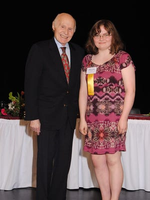 A $3,000 Herb Kohl Educational Foundation 2015 Initiative Scholarship was recently presented to Sheboygan Area Lutheran High School student Melissa Eiden, right, at a recognition luncheon hosted by retired Sen. Herb Kohl.