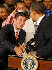 President Barack Obama shakes hands with Tim Tebow in the White House back in 2009.