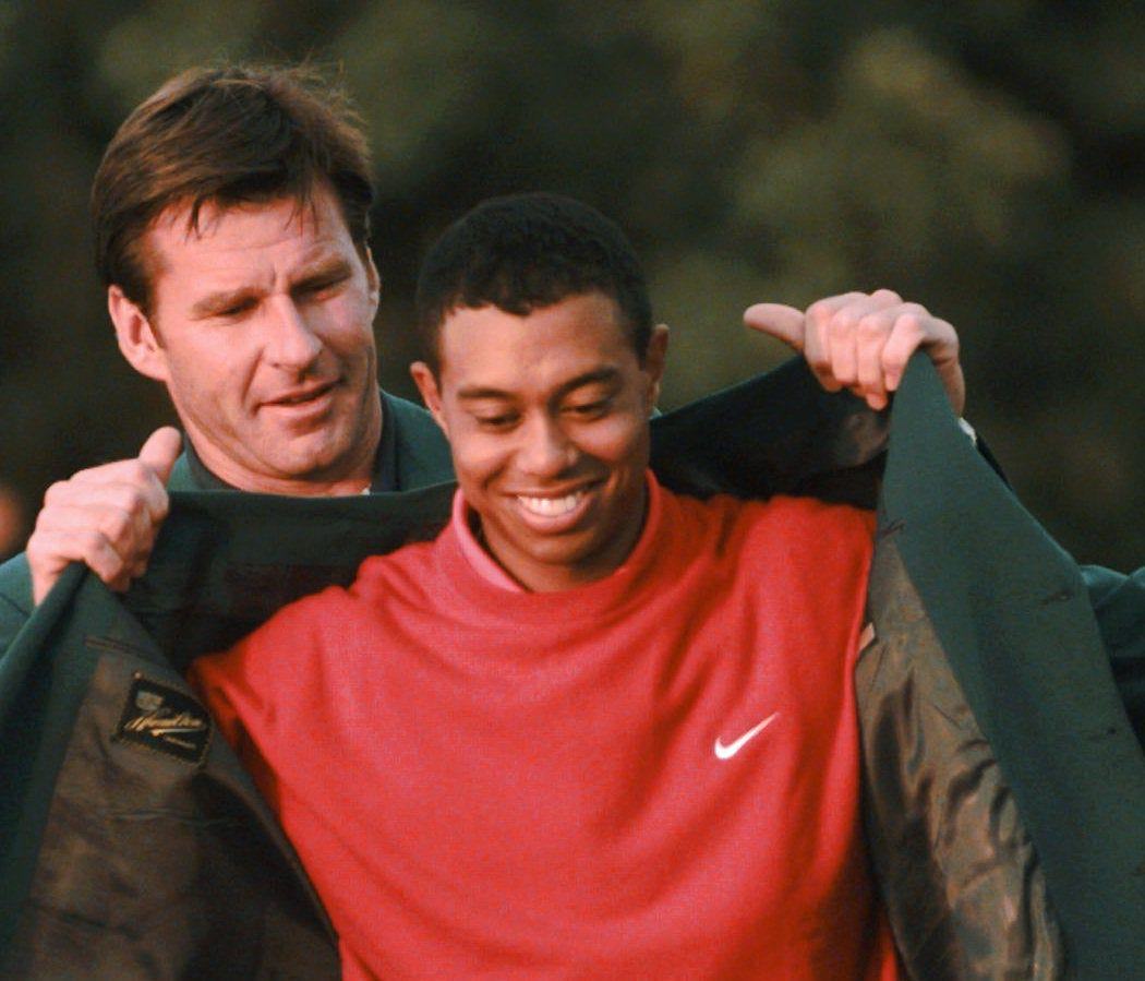 FILE - In this April 13, 1997 file photo, Masters champion Tiger Woods receives his Green Jacket from Nick Faldo at the Augusta National Golf Club in Augusta, Ga. Woods won the Masters by 12 shots, at the time the largest margin of victory in any maj