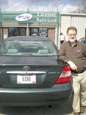 "Andy Balterman with his ""OIHO"" license plate."