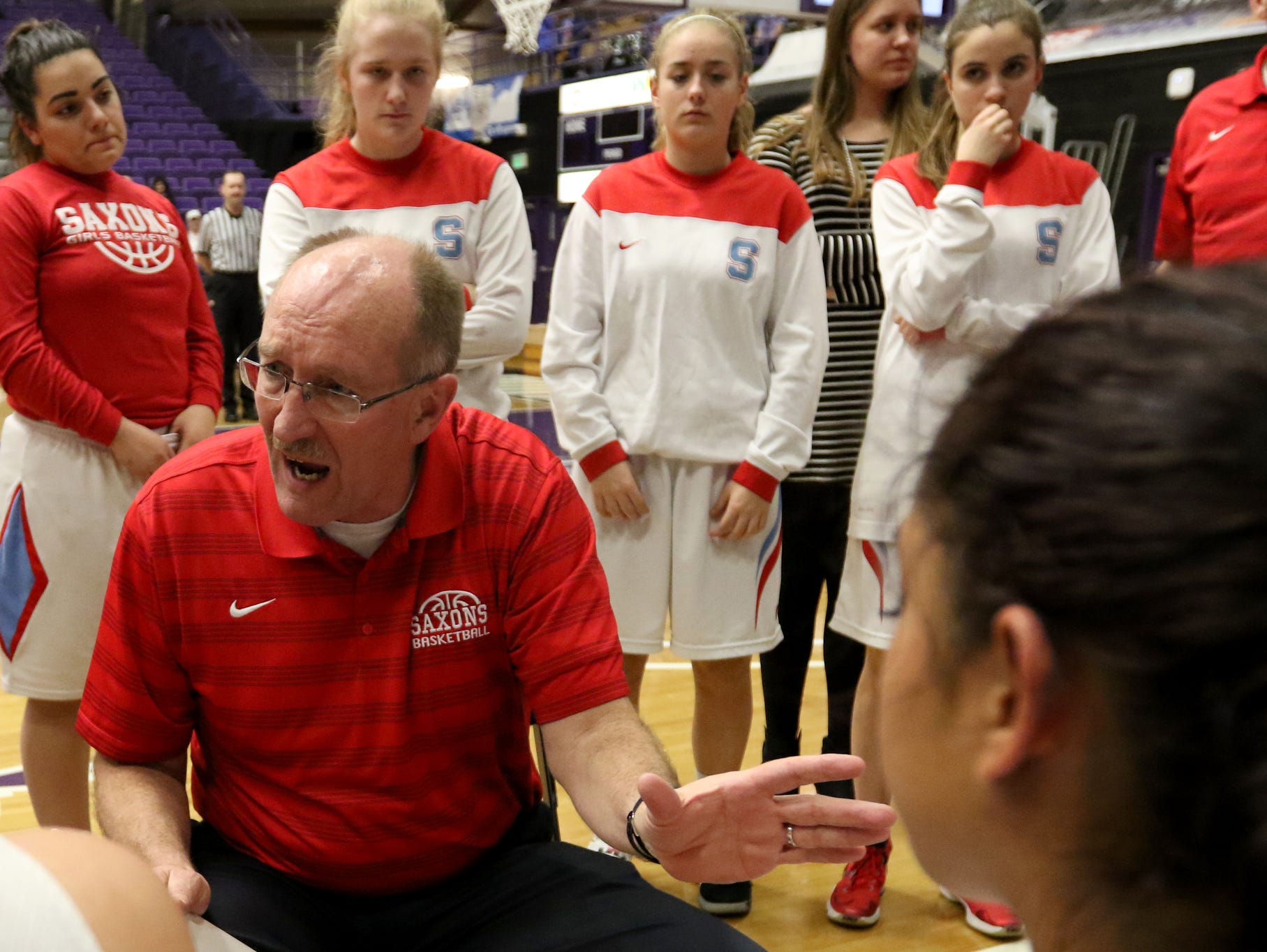 South Salem head coach Nick McWilliams talks with his team during a break in the second half of the Grant vs. South Salem girl's basketball game to determine third place in the OSAA Class 6A State Championships at the University of Portland on Saturday, March 11, 2017. South Salem won the game 58-53.
