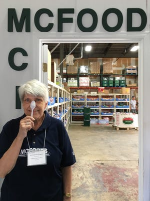 """Long-time MCFOODS' volunteer poses for """"Spoontember."""""""