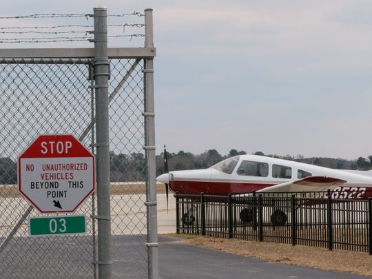 No trespassing signs warn those outside the Anderson Regional Airport fence near the terminal in Anderson.