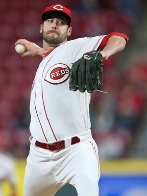 Cincinnati Reds relief pitcher Dylan Floro (63) delivers in the ninth inning during the National League baseball game between the Atlanta Braves and the Cincinnati Reds, Wednesday, April 25, 2018, at Great American Ball Park in Cincinnati.