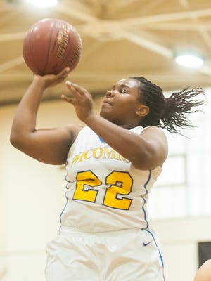 CLUTCH MOMENT: Wicomico's Marissa Taylor-James takes a shot against Crisfield on Monday afternoon at Wicomico High. Her two late free throws sealed a Wi-Hi win against Crisfield.