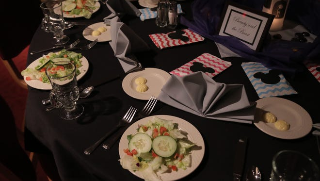 Dinner is served at a local prom in this News Journal file photo.