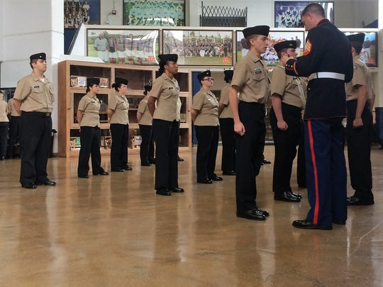 Cadet Aaron Mosqueda and the Central High School ROTC cadets participate in a personal inspection at Farragut High School on Nov. 7, 2017.