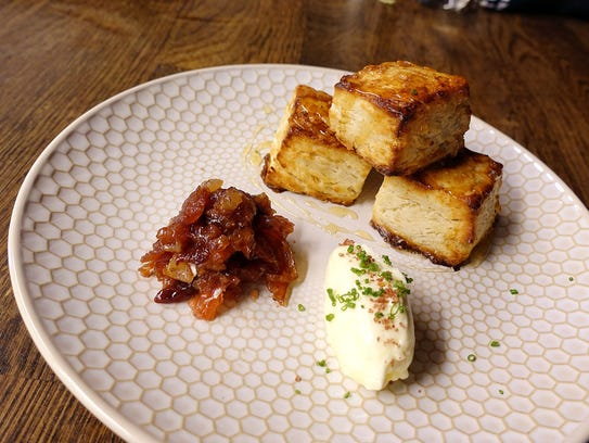 WTF Biscuits with house-made butter and plum-bacon jam at Second Story Liquor Bar.