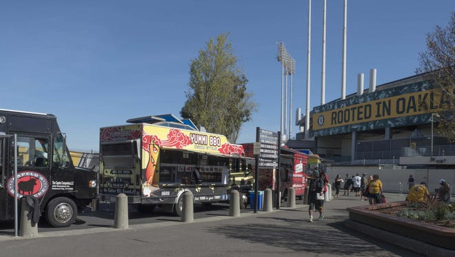 Food trucks park outside the Coliseum before a recent A's game.