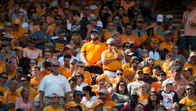 Tennessee fans stand in the stadium during a Tennessee vs. South Carolina game at Neyland Stadium in Knoxville, Tenn. Saturday, Oct. 14, 2017.