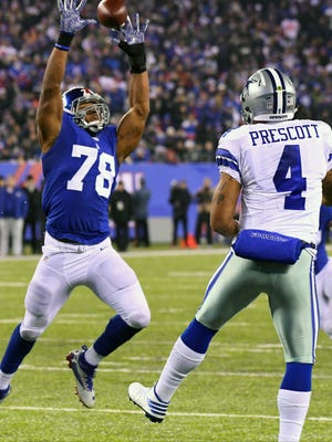 Giants defensive end Romeo Okwara (78) defends against a pass from Cowboys quarterback Dak Prescott (4) in the second half Sunday in East Rutherford, N.J.