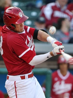 Indiana University's Austin Cangelosi pops a foul ball that was caught for an out against Notre Dame during their NCAA game at Victory Field in downtown Indianapolis on Tuesday, April 21, 2015. IU pulled out a 6-5 victory with three runs scored in the bottom of the ninth.