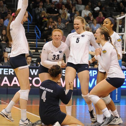 The Penn State Nittany Lions celebrate defeating the BYU Cougars at Chesapeake Energy Arena.