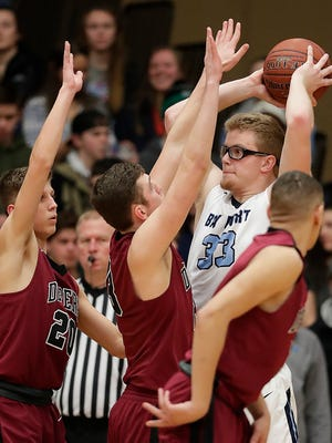 Bay Port center Jack Plumb is surrounded down low in a Fox River Classic Conference boys basketball game against De Pere on Friday. It was the Pirates' 10th straight win.