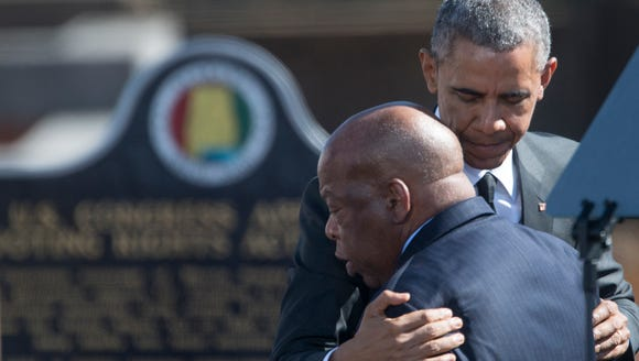 President Barack Obama hugs U.S. Rep. John Lewis before