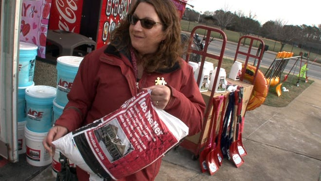 Debbie Schmidt, Cherry Hill, picks up some ice melter at the Beaver Dam Hardware store in Point Pleasant Friday. Her mother lives in Point Pleasant.