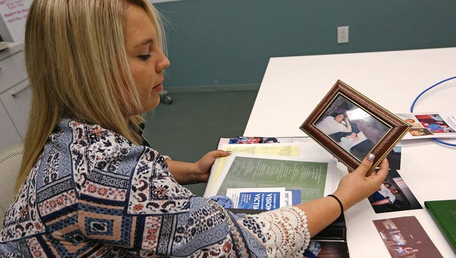 Jasmine Albarran, 17, shares photos, news clippings and other mementos of her family members who were killed in the Hamilton Avenue murders on June 1, 2006.