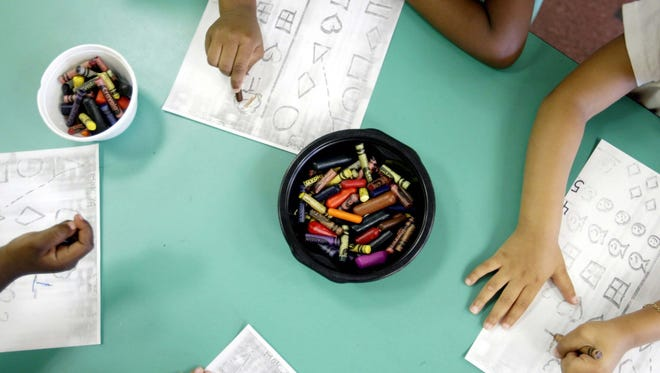 Free Press file photo.  Nursery school students perform an exercise where students have to match similar shapes together.