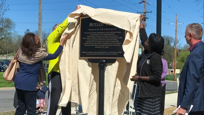 Members of the St. Cloud NAACP unveil the memorial plaque outside Butler Park. The St. Cloud park is named after Mary and John Butler who were brought to St. Cloud as slaves in 1857.
