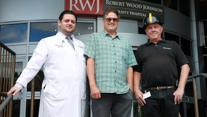 "Because of the ""Be Stroke Smart"" campaign at Robert Wood Johnson University Hospital in New Brunswick, Ron Walker (right) knew his employee Mark Czajkowski (middle) was suffering the symptoms of a stroke. Because of Walker's quick recognition, Czajkowski got to the hospital and Dr. Igor Rybbinik (left) in a timely fashion and is recovering well. He should return to work soon."