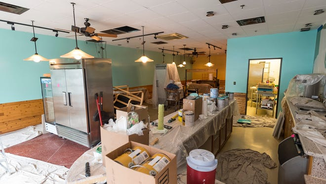 The walls and ceiling inside the former Sue's Coffee House in St. Clair are being repainted as the coffee house is redeveloped into the Simply Fresh Cafe.