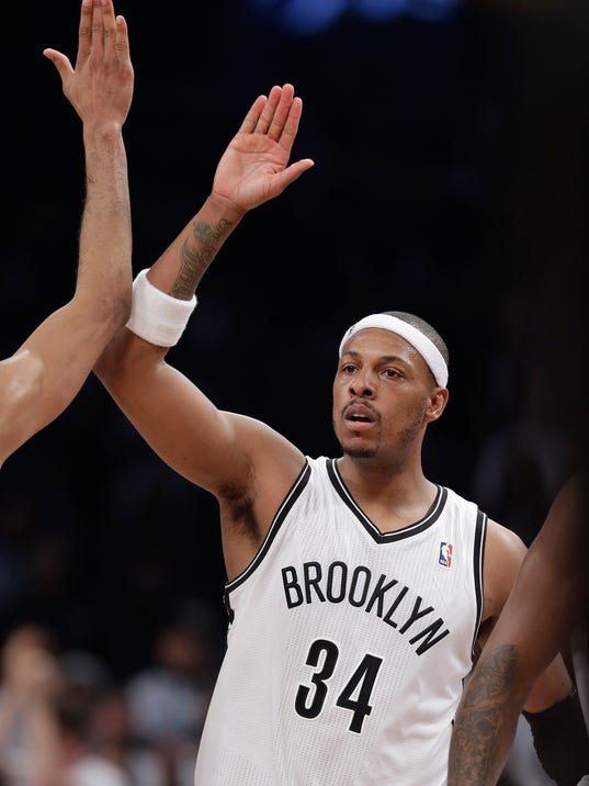 Brooklyn Nets forward Paul Pierce (34) celebrates with teammates after scoring against the Miami Heat in the fourth quarter during Game 3 of an Eastern Conference semifinal NBA playoff basketball game on Saturday, May 10, 2014, in New York. The Nets won 104-90. (AP Photo/Julie Jacobson)