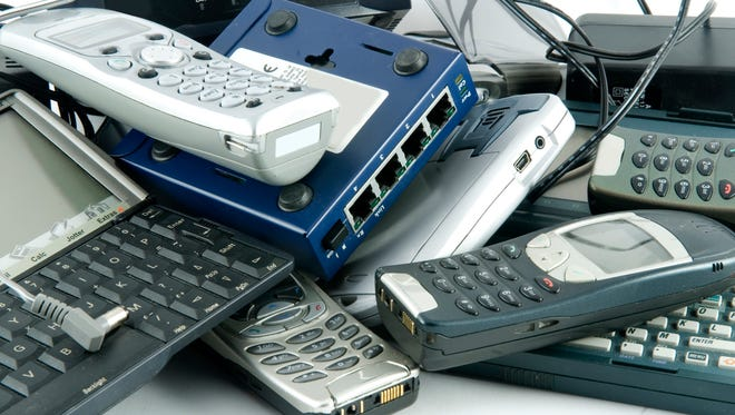 a selection of phones pda,s and network equipment that has become obsolete