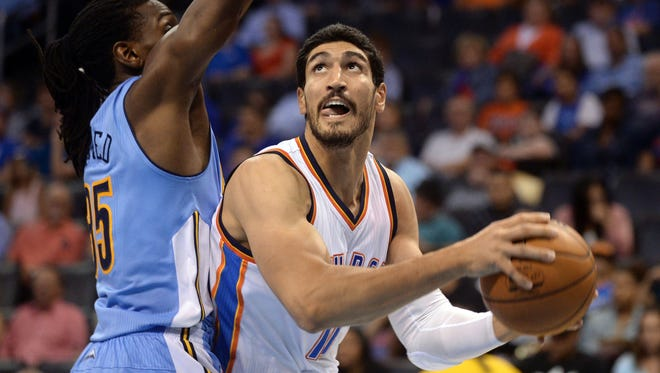 Oklahoma City Thunder center Enes Kanter (11) drives to the basket in front of Denver Nuggets forward Kenneth Faried (35) during the third quarter at Chesapeake Energy Arena.