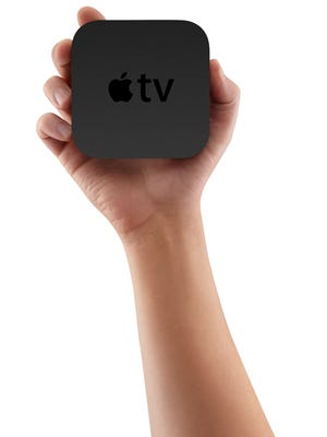 The sleek new Apple TV has been completely retuned for your entertainment. It's 80 percent smaller than the previous generation -- even with a built-in power supply. Which makes it perfect for sitting neatly on a widescreen TV stand or squeezing into a crowded media cabinet. Not only does the new Apple TV have an amazingly small footprint, it's also incredibly energy efficient. It stays cool without a fan, so it's never noisy. And when it's not filling your living room with drama, romance, and comedy, it uses less power than a night-light. The cost: $99.