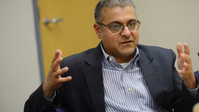 Sandeep Kaushik, Measure 92 proponent, meets with the Statesman Journal Editorial Board during a meeting on Thursday, Sept. 11, 2014.