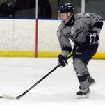 Senior defenseman Richard Lantz moves the puck out of the Farmington zone.