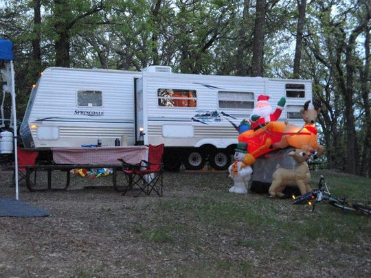 Michelle and Jamie Pullman of St. Joseph camp in almost any weather. Holiday inflatables helped set the mood during a recent fishing opener at Sibley State Park.