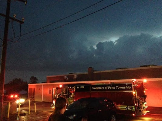 Penn Township fire officials respond to a reported lightning strike at Apostolic Ministries in Penn Township on May 18.