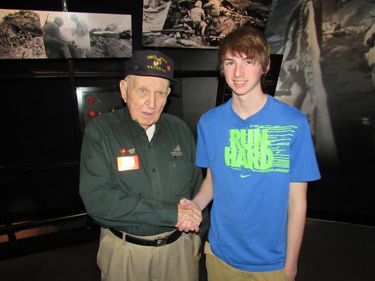 """Jesse Watson of West Manchester Township submitted this photo to the YDR Travel gallery Jan. 5. Watson writes, """"My son, Ian, shakes the hand of WWII Iwo Jima veteran Frank Matthews at the National Museum of the Marine Corps near Quantico, VA."""""""