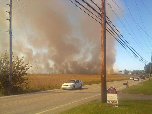 A car passes a wildfire on South Forge Road in South Londonderry Township Wednesday afternoon.