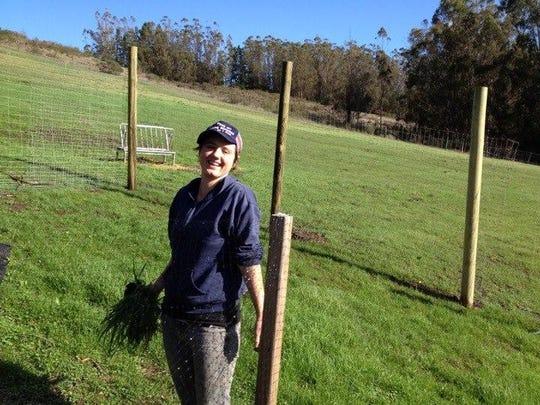 Laura Mulley stands in a garden at a retreat center in Sebastopol, California, in 2014.