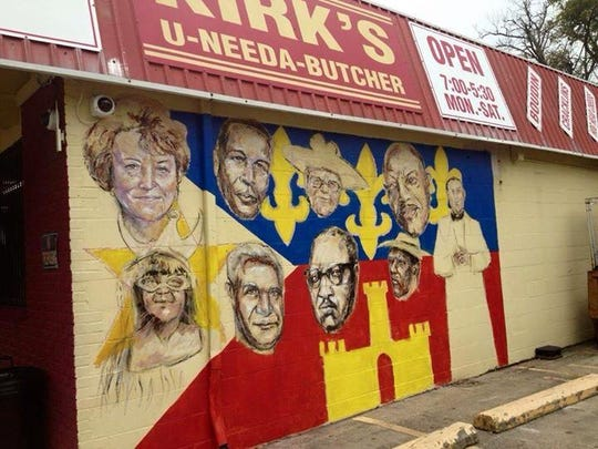 This mural by Adrian Fulton features nine faces of the McComb-Veazey neighborhood on the side of Kirk's U Needa Butcher.