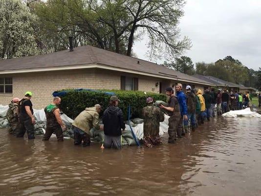 MAIN PHOTO 1D Guys around flooded house