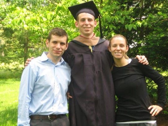 Kevin Brown (center) with brother Matthew and sister Heather at his graduation from Rider University.