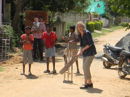 """Jennifer Hillman-Magnuson, author of """"Peanut Butter and Naan,"""" plays cricket in India. Jennifer, husband Robert and five children ages 1 to 14 moved to Chennai, India, in 2010. The trip is the subject of Jennifer's memoir."""