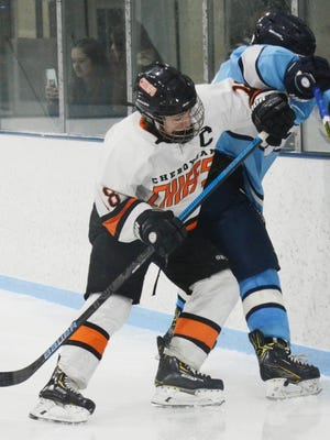 Cheboygan's Justin Horrocks (left) checks a Petoskey player into the boards during a hockey game from the 2019-20 season. Horrocks, a senior defenseman, is returning for his fourth varsity season with the Chiefs.